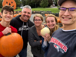 Denise anderson and her family at a pumpkin patch